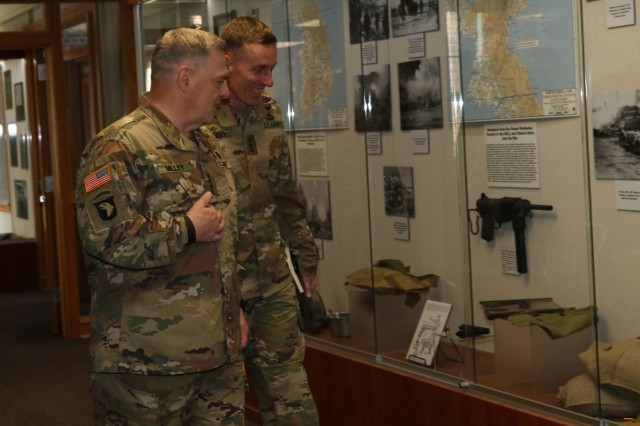"Chief of Staff of the Army Gen. Mark A. Milley and America's First Corps Commanding General Lt. Gen. Gary Volesky comment on the historical displays that line the hallways at the I Corps headquarters on Joint Base Lewis-McChord, Washington, July 23, 2018. Milley visited JBLM to meet with Soldiers and leaders from I Corps, 7th Infantry Division, 1st Special Forces Group and 2nd Battalion, 75th Ranger Regiment. Milley discussed Soldier and Family readiness and the future of the force. Americas First Corps is celebrating its ""100 Years of Courage"" centennial throughout 2018. U.S. Army photo by Spc. Erica Earl"