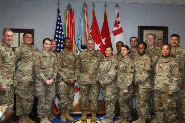Chief of Staff of the Army, Gen. Mark A. Milley (middle), America's First Corps Commanding General, Lt. Gen. Gary Volesky (far left), I Corps Chief of Staff, Col. Mario Diaz (far right, second row) and I Corps Command Sergeant Major Command Sgt. Maj. Walter Tagalicud (far right, first row) take a group photo with awardees during a visit to America's First Corps headquarters building on Joint Base Lewis-McChord, Washington, July 23, 2018. 555 Engineer Brigade was recognized for winning two categories in the Chief of Staff of the Army Excellence Award program, while others received recognition for their individual accomplishments.  Milley visited JBLM to meet with Soldiers and leaders from I Corps, 7th Infantry Division, 1st Special Forces Group and 2nd Battalion, 75th Ranger Regiment. Milley discussed Soldier and Family readiness and the future of the force.U.S. Army photo by Sgt. William Brown