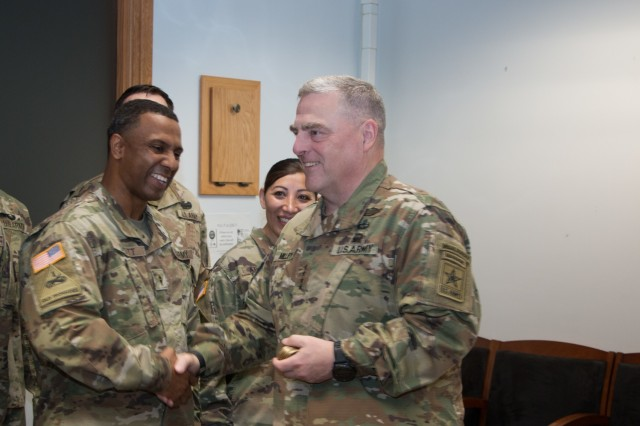 Chief of Staff of the Army Gen. Mark A. Milley presents Chief Warrant Officer 2 Torrey Scott, the battalion maintenance technician for the 864th Engineer Battalion, 555 Engineer Brigade with the Army Award for Maintenance Excellence at the America's First Corps headquarters building on Joint Base Lewis-McChord, Washington, July 23, 2018. The battalion won the Modification Table of Organization and Equipment large category in an Army-wide competition for achievement in logistics and maintenance and dedication to increasing mission readiness.  The award is part of the Chief of Staff of the Army Excellence Award program. U.S. Army photo by Sgt. William Brown