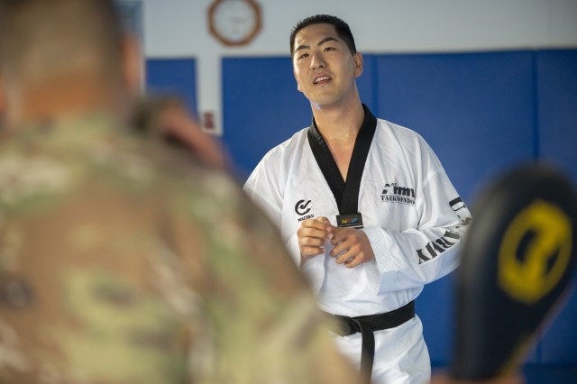 Spc. Jungsuk Moon, a medical laboratory specialist with the 65th Medical Brigade, talks strategy with Master Sgt. David Ruiz inside a gym at Yongsan Garrison, South Korea, June 4, 2018.