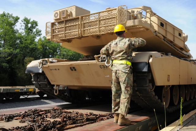 Master Sgt. Nathaniel Ketchum, battalion master gunner with the Ohio Army National Guard's 1st Battalion, 145th Armored Regiment, checks the M1A1 Abrams tank prior to it being off-loaded at Fort Knox, Kentucky, July 19, 2018. The vehicles will be kept and maintained at the Kentucky National Guard's Maneuver Area Training Equipment Site (MATES) facility. (U.S. Army National Guard photo by staff Sgt. Benjamin Crane)