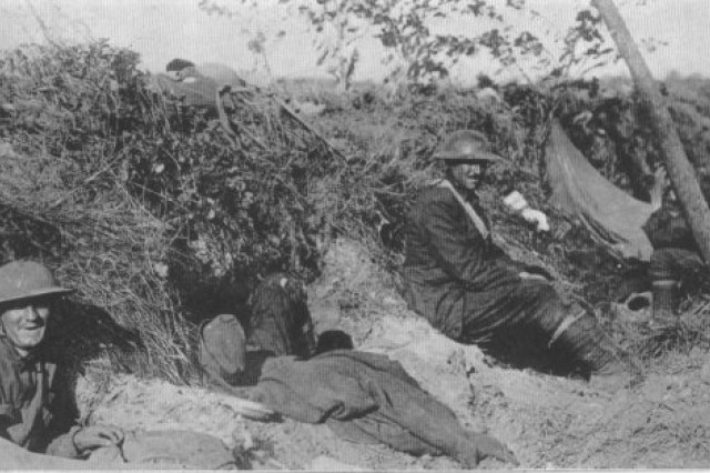 U.S. Army National Guard Soldiers from the 42nd Division's Company H, 167th Infantry in hasty fighting positions near Rheims in early July 1918. Just two weeks after its defensive actions at Champagne from July 14-16, the division initiated offensive operations in late July 1918 as part of the Aisne Marne attacks near Chateau Thierry, France. The 42nd Division seized Croix Rouge Farm and crossed Ourcq River July 29th, aided by two battalions from the 4th Division. They captured Sergy, Meurcy Farm and Seringes-et-Nesles, advancing on the 30th to Foret de Nesles and beyond Sergy.