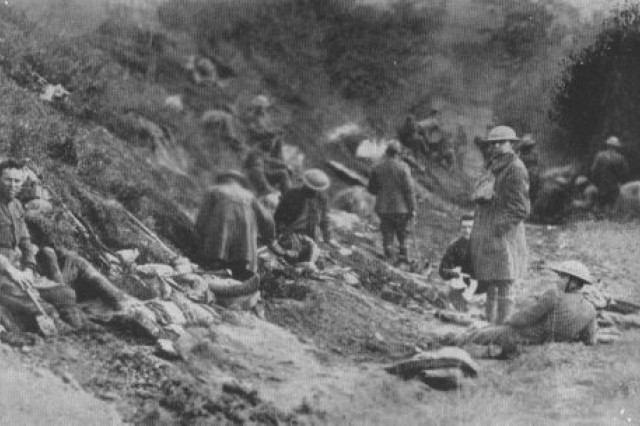 U.S. Army National Guard Soldiers from the 42nd Division pause during offensive operations in late July 1918 as part of the Aisne Marne attacks near Chateau Thierry, France. The 42nd Division seized Croix Rouge Farm and crossed Ourcq River July 29th, aided by two battalions from the 4th Division. They captured Sergy, Meurcy Farm and Seringes-et-Nesles, advancing on the 30th to Foret de Nesles and beyond Sergy.