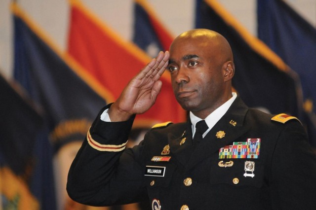 Chief Warrant Officer 5 Jermain C. Williamson Sr., the new Transportation Corps Regimental Warrant Officer, salutes during the Trans. Corps RWO Change of Command Ceremony July 16 at Wylie Hall. Williamson succeeded CWO 5 Donald E. Berg Jr.
