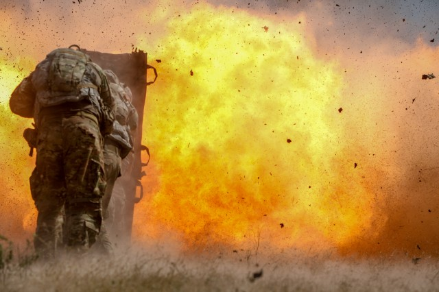 Combat engineers from the 2nd Armored Brigade Combat Team, 1st Cavalry Division blast through a concrete wall during demolitions training July 17.