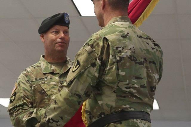 Col. Joseph Morrow transfers the Watervliet Arsenal colors to Maj. Gen. Daniel Mitchell, Commanding General U.S. Army Tank-Automotive and Armaments Command, during the relinquishment of command ceremony at the Watervliet Arsenal on July 24, 2018.