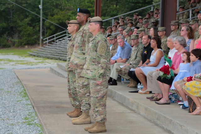 FORT BENNING, Ga. (July 24, 2018) - From background to foreground, Col. Michael A. Scarpulla, incoming commander of the Airborne and Ranger Training Battalion, Maj. Gen. Gary M. Brito, commanding general of the Maneuver Center of Excellence and Fort Benning, and Col. Douglas G. Vincent, outgoing commander of the ARTB, stand together during the ARTB change of command ceremony. The ARTB held a change of command July 24 at Victory Pond at Fort Benning, Georgia, welcoming Scarpulla to command and bidding farewell to Vincent. (U.S. Army photo by Markeith Horace, Maneuver Center of Excellence, Fort Benning Public Affairs)