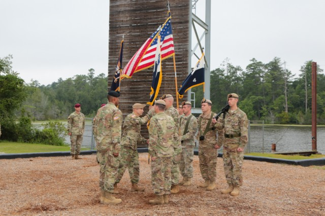FORT BENNING, Ga. (July 24, 2018) - Col. Michael A. Scarpulla, incoming commander of the Airborne and Ranger Training Battalion, passes off the unit guidon. The ARTB held a change of command July 24 at Victory Pond at Fort Benning, Georgia, welcoming Scarpulla to command and bidding farewell to Col. Douglas G. Vincent. (U.S. Army photo by Markeith Horace, Maneuver Center of Excellence, Fort Benning Public Affairs)