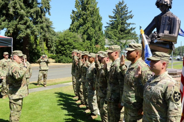 Gen. Mark Milley, Army Chief of Staff, administers the oath of enlistment to a group of 7th Infantry Division Soldiers during his visit to Joint Base Lewis-McChord, Wash., July 23, 2018. Traditionally, during a Soldiers' reenlistment into the Army, the oath must be administered by a commissioned officer. (U.S. Army photo by Staff Sgt. Michael Armstrong, 7th Infantry Division)