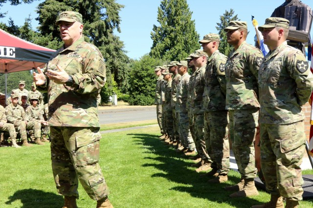 Gen. Mark Milley, Army Chief of Staff, speaks to a group of 7th Infantry Division Soldiers about the meaning of service to country prior to a reenlistment ceremony during his visit to Joint Base Lewis-McChord, Wash., July 23, 2018. (U.S. Army photo by Staff Sgt. Michael Armstrong, 7th Infantry Division)