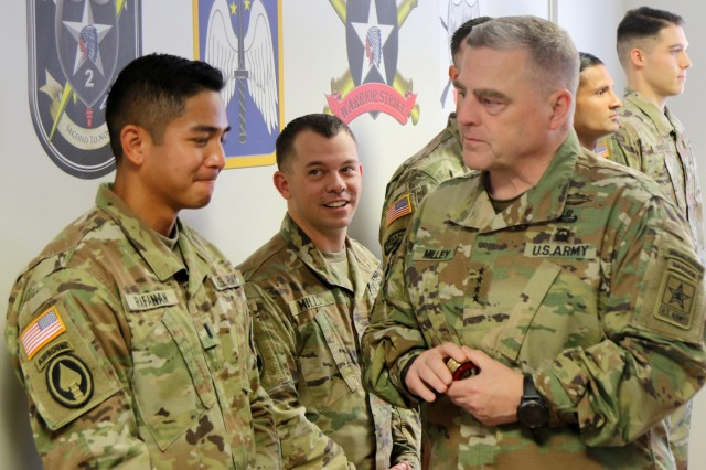 Gen. Mark Milley, Army Chief of Staff, speaks with 1st Lt. Garfield Rafanan, 7th Infantry Division's Junior Officer of the Year during his visit to Joint Base Lewis-McChord, Wash., July 23, 2018. Rafanan was recognized for his performance during the 2018 Bayonet Division Best Warrior Competition. (U.S. Army photo by Staff Sgt. Michael Armstrong, 7th Infantry Division)