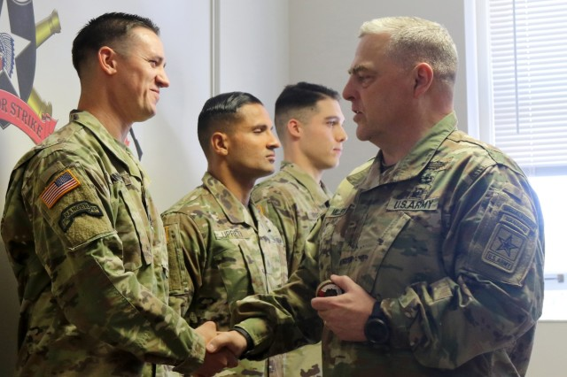 Gen. Mark Milley, Army Chief of Staff, speaks with 1st Sgt. Brenden Shannon, 7th Infantry Division's First Sergeant of the Year during his visit to Joint Base Lewis-McChord, Wash., July 23, 2018. Shannon was recognized for his performance during the 2018 Bayonet Division Best Warrior Competition. (U.S. Army photo by Staff Sgt. Michael Armstrong, 7th Infantry Division)