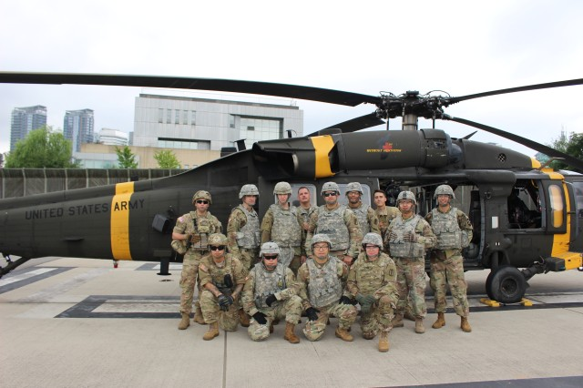 Soldiers from C Company, 121st Combat Support Hospital and C Company, 3rd General Support Aviation Battalion, 2nd Aviation Regiment, 2nd Combat Aviation Brigade, 2nd Infantry Division celebrate the successful completion of medical evacuation training July 12 at the USAG Yongsan heliport.