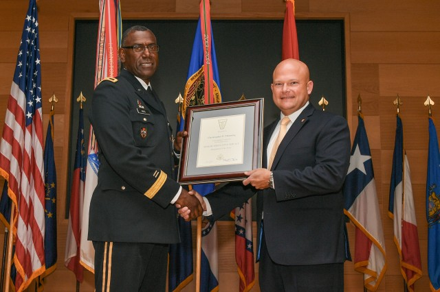 Chris P. Manning, director of the Command, Power and Integration Directorate in the U.S. Army Research, Development and Engineering Command's Communication-Electronic center, joined the ranks of the Senior Executive Service in a ceremony hosted by MG Cedric Wins, RDECOM commanding general, during a promotion ceremony held on July 18 at the Myer Auditorium, Aberdeen Proving Ground, Md.