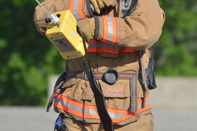 Fort Riley firefighter Sam McCallum radios in his report from the scene after responding to the reported chemical attack at Grant Gate.