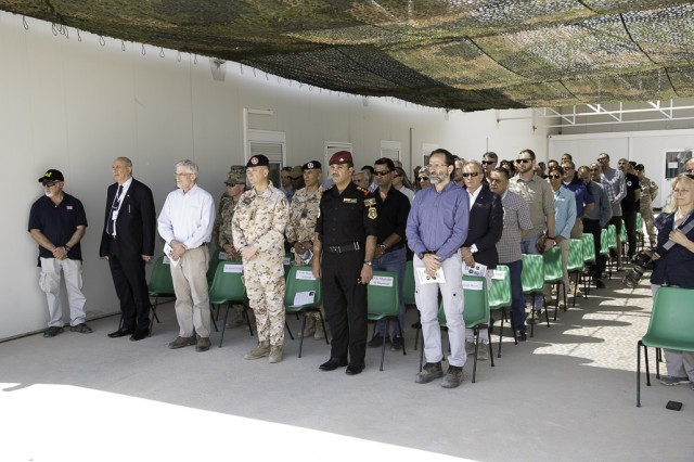 The multi-national audience for the Mosul Dam Task Force change of command ceremony included government officials from Iraq, Italy and the United States. From left, Mr. Riyadh, Ministry of Water Resources; Howard Stickley, Director of Programs and Business, Transatlantic Division; Col. Settesoldi, Commander, Task Force Presidium; Col. Muntadar, Iraq; and Mr. Miconi, Project Manager, Trevi.