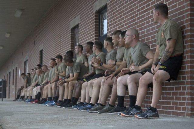 Soldiers from 1st Battalion, 9th Field Artillery Regiment, 3rd Infantry Division Artillery, perform physical training during a competition as part of the Affirmation of Life event hosted by 3rd ID Artillery, at Fort Stewart, Ga., July 20, 2018. Affirmation of Life was an all-day event that focused on showing Soldiers why every day is worth living. (U.S. Army photo by Spc. Zoe Garbarino/Released)