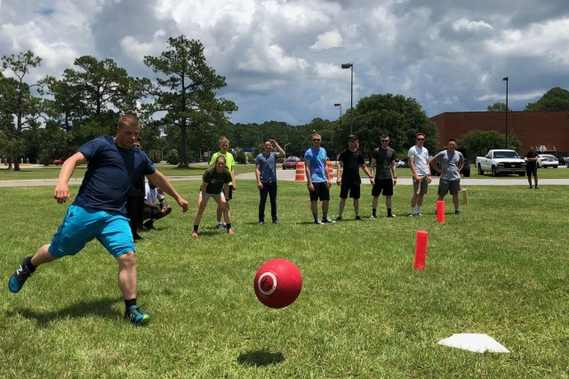 A Soldier from 3rd Infantry Division Artillery kicks a kickball during an Affirmation of Life event, hosted by 3rd ID Artillery, at Fort Stewart, Ga., July 20, 2018. Affirmation of Life was an all-day event that focused on showing Soldiers why every day is worth living. (U.S. Army photo by Spc. Zoe Garbarino/Released)