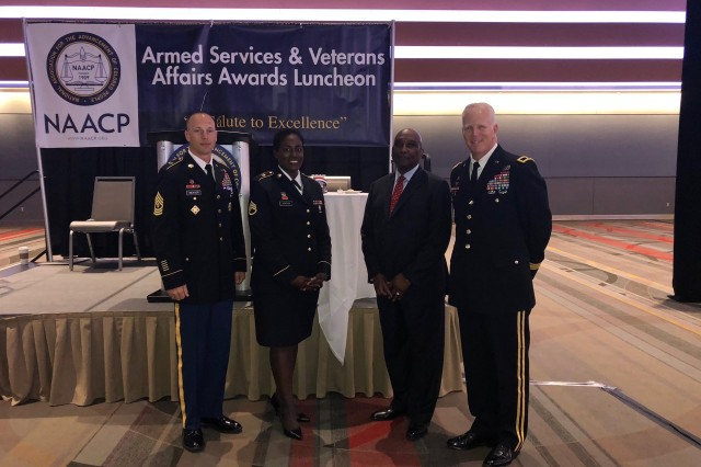 From left to right: 1st Sgt. Jeffrey Weaver, 95th Clearance Company, 84th Engineer Battalion; Staff Sgt. Ashli Africain, 71st Chemical Company, 303rd Ordnance Battalion; James Braxton Sr., Director of the Office of Equal Employment Opportunity at U.S. Army Corps of Engineers, Headquarters; Brig. Gen. Paul E. Owens (left), Commander of the Southwestern Division, U.S. Army Corps of Engineers pose for a photo at the NAACP Armed Services and Veteran Affairs Awards Luncheon on July 17th where Staff Sgt. Africain was presented the NAACP Roy Wilkins Renown Service Award.