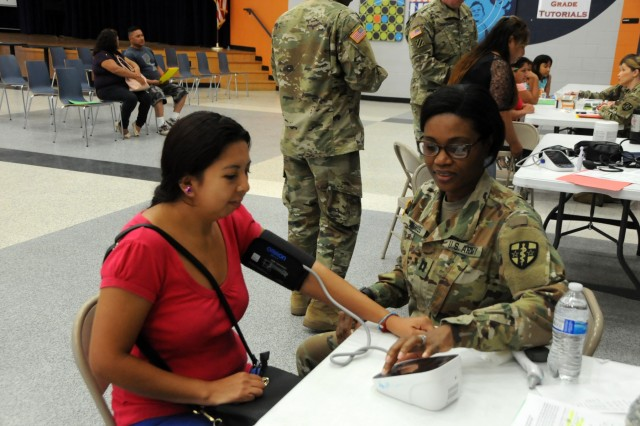 Capt. Rhonda Inniss, a medical surgical nurse, completes vitals for local residents waiting for medical services at Betty Harwell Middle School in Edinburg, Texas. Approximately 50 U.S. Army Reserve Soldiers assigned to the 7235th Medical Support Unit out of Orlando, Texas, worked in partnership with the Texas A&M Colonias program June 16-27 to provide medical care to Hidalgo County's underserved colonia population. Services provided by military personnel are done through the Department of Defense's Innovative Readiness Training, a civil-military program that builds mutually beneficial partnerships between U.S. communities and the DoD. The missions selected meet training & readiness requirements for Army Reserve service members while integrating them as a joint and whole-of-society team to serve our American citizens.