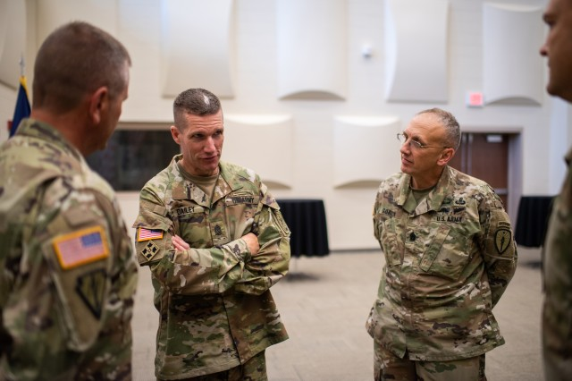 "Sgt. Maj. of the Army Daniel Dailey discusses readiness, modernization, the ""pink and green"" uniform, and the new Army Combat Fitness Test with Hoosier Soldiers during a town hall meeting at the Indiana National Guard Headquarters in Indianapolis, Ind. on July 25, 2018."