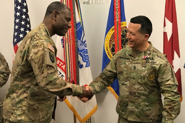 Maj. Gen. Wins, RDECOM commanding general and Command Sgt. Maj. Gutierrez shake hands at an awards ceremony, held July 19. Wins awarded the Meritorious Service Medal, Two-Star note and RDECOM Commanding General's coin to Gutierrez.