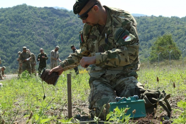 Ranger candidates in the first International Ranger Assessment, assemble, disassemble and simulate detonation of a Claymore mine during the first International Ranger Assessment at Camp Nothing Hill, Kosovo, July 21, 2018. The two-day assessment, hosted by Rangers with the 3rd Squadron, 61st Cavalry Regiment, 2nd Infantry Brigade Combat Team, 4th Infantry Division, allowed each candidate to familiarize themselves on what is expected at Ranger School in order to earn the coveted Ranger tab. (U.S. Army photo by Spc. Jarel Chugg, 19th Public Affairs Detachment)