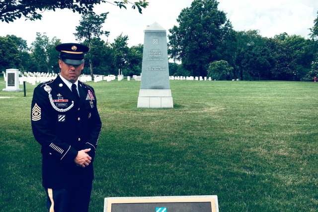 CSM Daniel Hendrex of the 3rd Infantry Division stands next to the 3rd Infantry Division Memorial at Arlington National Cemetery, Arlington, Va.