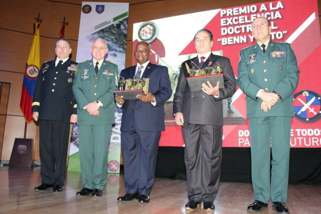 "Senior military leaders from Colombia and Maj. Gen. Mark R. Stammer, U.S. Army South Commander, (left) presented the first annual Benn and Soto Award for excellence in doctrine development June 6, 2018, in Bogota, Colombia. Combined Arms Doctrine Directorate Deputy James ""Jim"" Benn (third from left) and Carlos Soto (second from right), CADD terminologist, were selected as the first two recipients for their work since 2015 in support of the Colombian army's doctrine development."