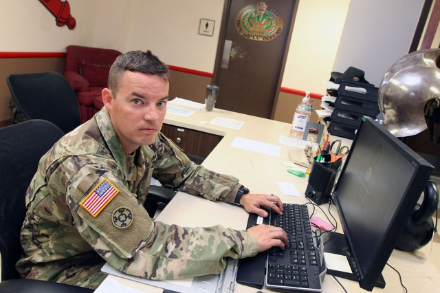 Reserve Drill Sergeant (Sgt. 1st Class) William Bowie, works charge of quarters (CQ) duty July 16, 2018, at E Battery, 1st Battalion, 31st Field Artillery at Fort Sill. As a Reserve Soldier, Bowie had to attend the Drill Sergeant School at Fort Jackson, S.C., to become a drill sergeant just like active-duty Soldiers do.