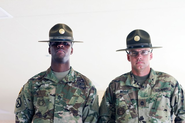 Reserve Drill Sergeants (Sgts. 1st Class) John Owens and Jarod Moss perform drill sergeant duty at basic combat training centers each summer. In their civilian jobs, Owens is a psychiatrist in Dayton, Ohio, and Moss is a teacher at Waxachie (Texas) High School and a basketball coach.