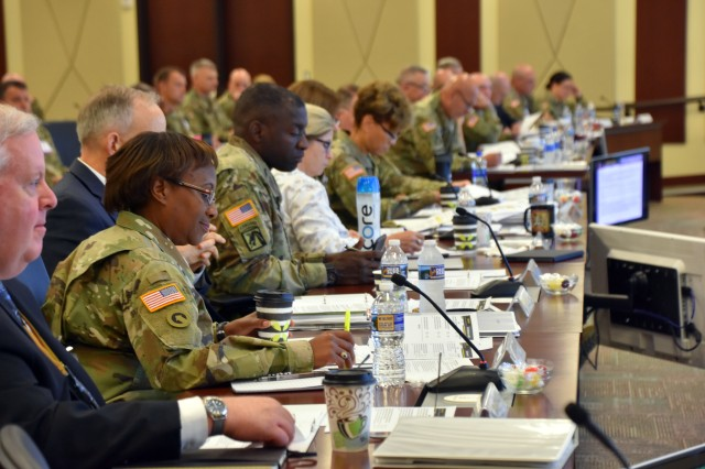 Leaders from across the Department of Defense, the Army and Fort Bragg meet at U.S. Army Forces Command headquarters July 19, 2018, to discuss the upcoming transition of the administration and management of Womack Army Medical Center from the U.S. Army Medical Command to the Defense Health Agency.  (U.S. Army photo by Eve Meinhardt/FORSCOM PAO)