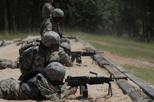 Georgia Army National Guardsmen, Spc. Emilee Shackleford and Pfc. Morgan Bell, military policemen assigned to the Decatur based 170th Military Police Battalion, engage targets during M249 Squad Automatic Weapon's qualification on July 17, 2018, at Fort Stewart. More than 1100 Guardsmen from across the state are attending annual training there for the next two weeks.