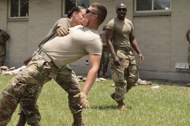 Georgia Army National Guardsman Pfc. Alexia Smyre, a military policeman from the Monroe based 178th Military Police Company, utilizes Muscular Control Techniques (MAC) to bring Spc. Matthew Waters under control during less-lethal training on July 20, 2018 at Fort Stewart, Ga.  Military Policemen train with a variety of MAC techniques to apprehend and control suspects.