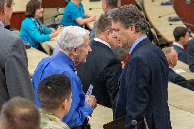 Kansas Governor Jeff Colyer talks with Lt. Gen. (Ret.) Robert Arter, Civilian Aide to the Secretary of the Army (Emeritus) before presenting certificates of completion to graduates of the Hiring our Heroes Corporate Fellowship Program at Fort Leavenworth July 26.