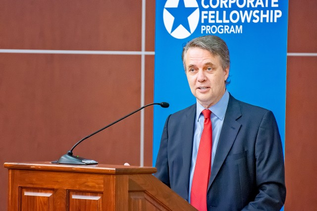 Kansas Governor Jeff Colyer talks with graduates of the Hiring our Heroes Corporate Fellowship Program at Fort Leavenworth July 26.