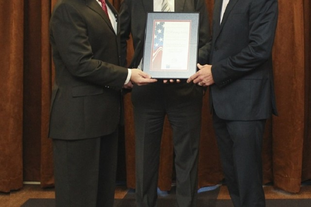Stephen Evans, left, Army Materiel Command program manager for the installation master planning, and Joel Ball, right, Corps of Engineers program manager, receive the Outstanding Federal Planning Program award from the American Planning Association in 2016.