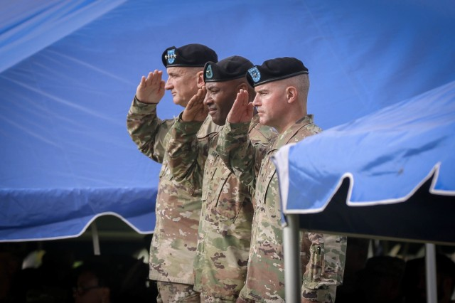 U.S. Army Brig. Gen. Sean A. Gainey (center), the outgoing 94th Army Air and Missile Defense Command's commander, Gen. Robert B. Brown (left), the commander of the U.S. Army Pacific, and Brig. Gen. Michael Morrissey (right), the incoming 94th AAMDC commander, salute the nations colors, during a change of command ceremony at the historic Palm Circle, July 26, 2018 at Fort Shafter, Hawaii.
