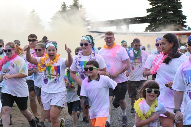 More than 500 Fort Drum community members got pretty in pink, bathed in blue and were going green at Division Hill on July 26 when they were showered in bright colors during the Color the Mountain fun run. (Photo by Mike Strasser, Fort Drum Garrison Public Affairs)