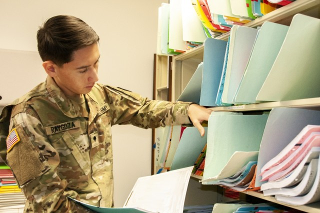 Spc. Levi Raygoza, patient administration specialist, 7248th Medical Support Unit, Army Reserve Medical Command, files patient records as part of an Annual Training event for the El Paso, Texas-based reserve unit at William Beamont Army Medical Center, July 20. The 7248th provided additional healthcare support to Soldiers, retirees, families and other beneficiaries in the El Paso, Texas area, July 8-20.