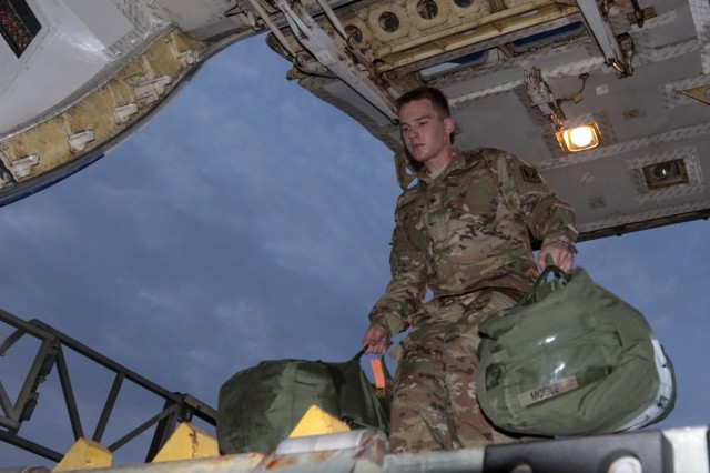 Georgia Army National Guardsman Spc. Kristofer M. Apanian with the Marietta based 1st Battalion, 171st Aviation Regiment loads Soldier equipment on a transport plane at Dobbins Air Reserve Base, Ga., on July 27, 2018. Apanin and more than 200 Georgia Guardsmen are traveling to Tbilisi, Republic of Georgia to conduct Noble Partner 18.   U.S. Army National Guard photo by Staff Sgt. R.J. Lannom Jr