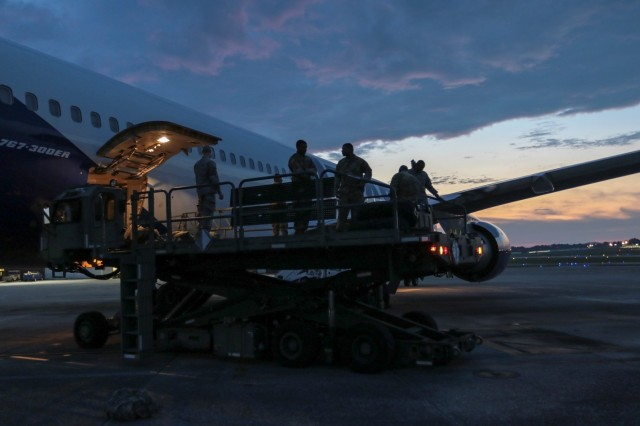 Georgia Army National Guardsmen from the Marietta, Ga. based 1st Battalion, 171st Aviation Regiment finish loading equipment at Dobbins Air Reserve Base, Ga., on July 27, 2018.  The unit will travel to Tbilisi, Republic of Georgia to participate in Noble Partner 18. U.S. Army photo by Staff Sgt. R.J. Lannom Jr