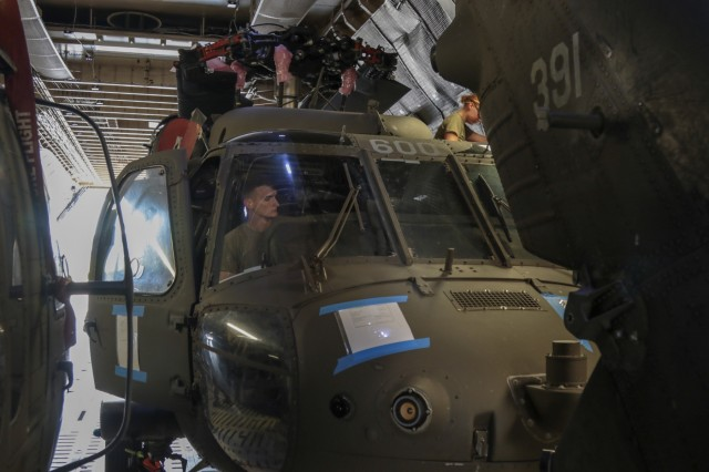A Georgia Army National Guard helicopter maintenance and support crew from the Marietta based 171st General Support Aviation Battalion, perform safety checks while loading a UH-60 Black Hawk on an U.S. Air Force Reserve C-5M Super Galaxy on July 24, 2018 at Dobbins Air Reserve Base, Marietta, Ga. . The helicopters are being transported to Tbilsi, Republic of Georgia for service in Noble Partner 18.