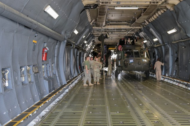 A Georgia Army National Guard helicopter maintenance and support crew from the Marietta based 171st General Support Aviation Battalion, ensure proper loading of  a UH-60 Black Hawk on an U.S. Air Force Reserve C-5M Super Galaxy on July 24, 2018 at Dobbins Air Reserve Base, Marietta, Ga. . The unit will support U.S. Army Europe and Georgian Armed Forces in the Republic of Georgia for Noble Partner 18, a coooperatively led multinational training exercise.