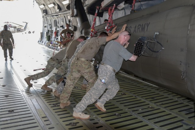 A Georgia Army National Guard helicopter maintenance and support crew from the Marietta based 171st General Support Aviation Battalion, push  a UH-60 Blackhawk into its final position on an U.S. Air Force Reserve C-5M Super Galaxy on July 24, 2018 at Dobbins Air Reserve Base, Marietta, Ga. . The unit will support U.S. Army Europe and Georgian Armed Forces in the Republic of Georgia for Noble Partner 18, a cooperatively led multinational training exercise.