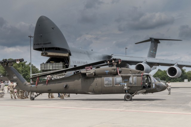 A Georgia Army National Guard UH-60 Black Hawk helicopter from the Marietta based 171st General Support Aviation Battalion waits to be loaded on an U.S. Air Force Reserve C-5 Super Galaxy on July 24, 2018 at Dobbins Air Reserve Base. The helicopters are being transported to Tbilsi, Georgia for service in Noble Partner 18.