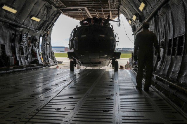 A Georgia Army National Guard helicopter maintenance and support crew from the Marietta based 171st General Support Aviation Battalion, ensure proper loading of  a UH-60 Black Hawk on an U.S. Air Force Reserve C-5M Super Galaxy on July 24, 2018 at Dobbins Air Reserve Base, Marietta, Ga. . The unit will support U.S. Army Europe and Georgian Armed Forces in the Republic of Georgia for Noble Partner 18, a cooperatively led multinational training exercise.