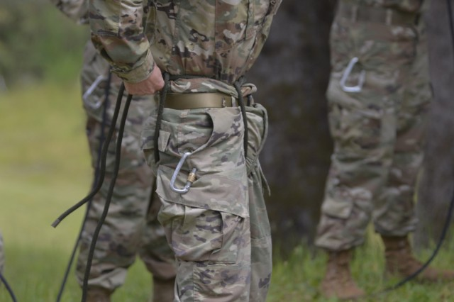 Idaho Army National Guard Spc. Ryan J. Pyfer practices tying a swiss seat ahead of a Rappel Master Personnel Inspection (RMPI) and rappel down a slanted wall as part of a a Rappel Master Course, June 12, 2018, at Camp Rilea near Warrenton, Oregon. More than 40 National Guard Soldiers from across the country attended the weeklong course which was taught by Warrior Training Center instructors from Fort Benning, Georgia.