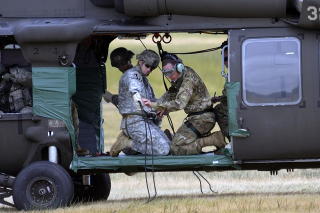 Army National Guard Soldiers prepare and complete final inspections during the aircraft command and control portion of their weeklong Rappel Master Course, June 13, 2018, at Camp Rilea, near Warrenton, Oregon. Soldiers and one graded Rappel Master student, under the guidance of Warrior Training Center instructors from Fort Benning, Georgia. The test demonstrates their ability to successfully send multiple rappelling Soldiers out of a rotary-wing aircraft at approximately 90-feet above the ground.