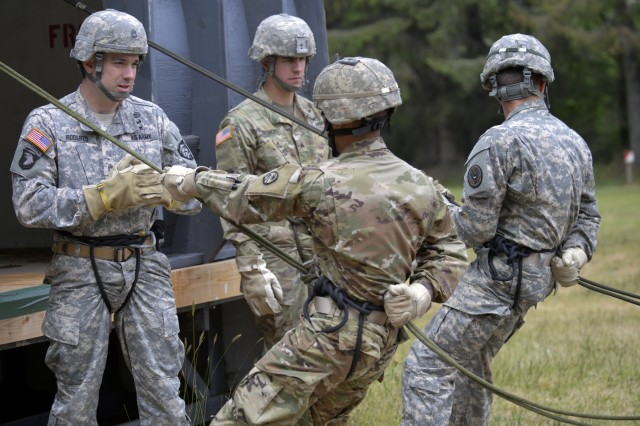 Oregon Army National Guard Staff Sgt. John M. Roberts and Nevada Army National Guard Sgt. Grant M. Reimers practice rappelling command with fellow student-Soldiers in a Rappel Master Course, June 12, 2018 at Camp Rilea near Warrenton, Oregon. Students in the course completed several practice rounds on the ground using mock-helicopters and a slanted wall before moving onto rappels from the 60-foot tower.